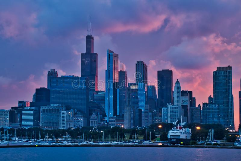 Stunning view of sunset over Chicago, seen from Lake Michigan, with boats in marina in foreground and city skyline behind. stock images