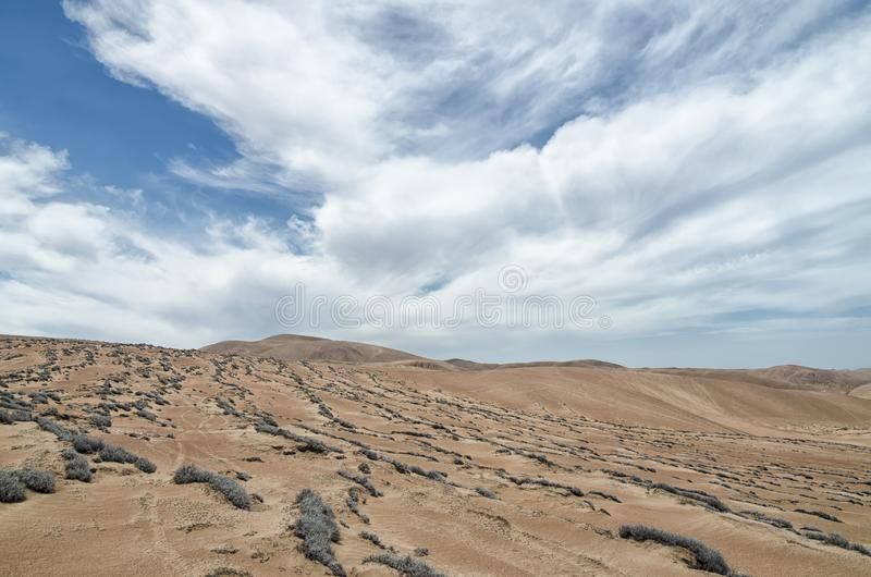 Stunning view to the desert under blue cloudy sky royalty free stock image