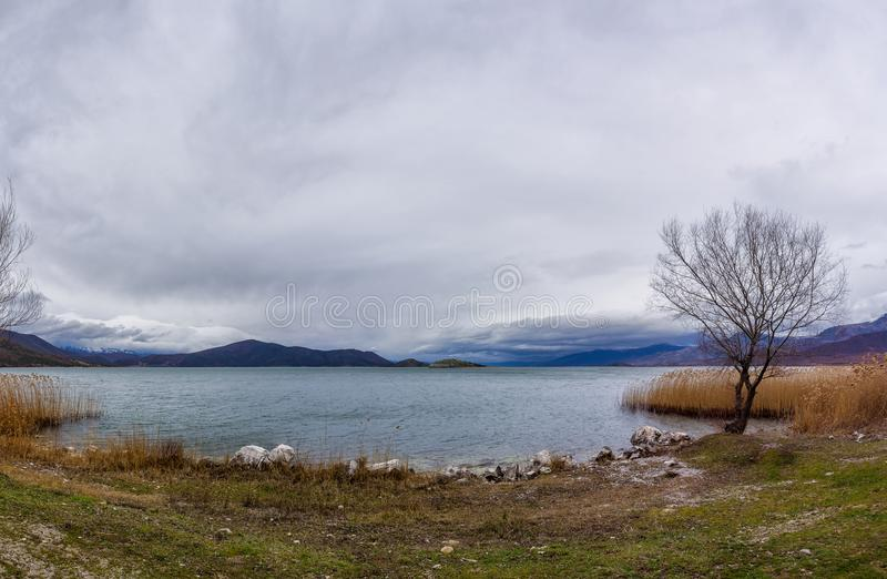 Stunning view to Prespes lakes and the surrounding scenery, Florina, Greece. Stunning view to Prespes lakes and the surrounding scenery, Florina, Macedonia stock photos