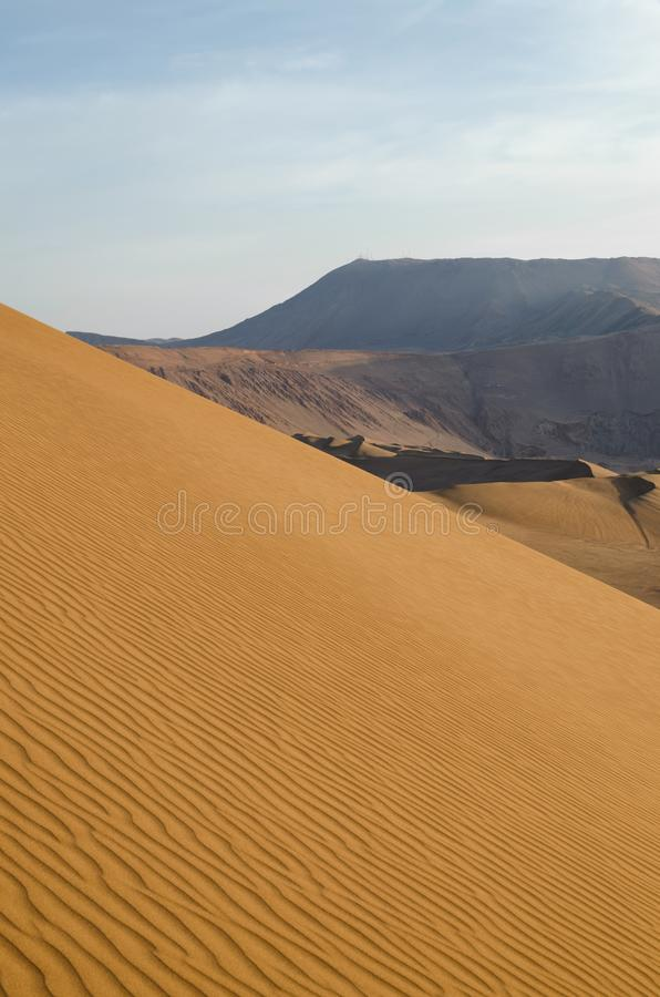 Stunning view to sand dunes and mountains stock photo