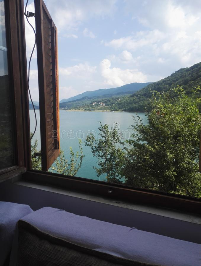 Stunning view to Zavoj lake through window stock photography