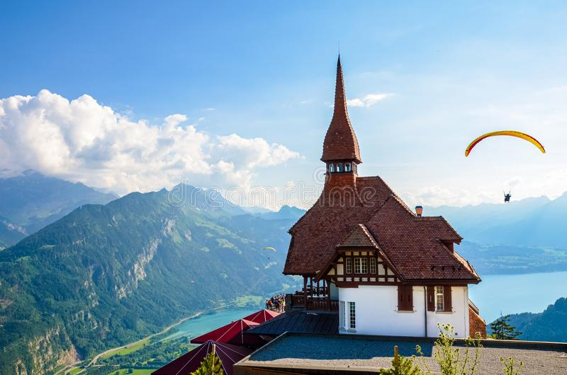 Stunning view of the top of Harder Kulm in Interlaken, Switzerland photographed in summer with paragliders flying around. Hilly. Alpine landscape and Lake Thun royalty free stock images