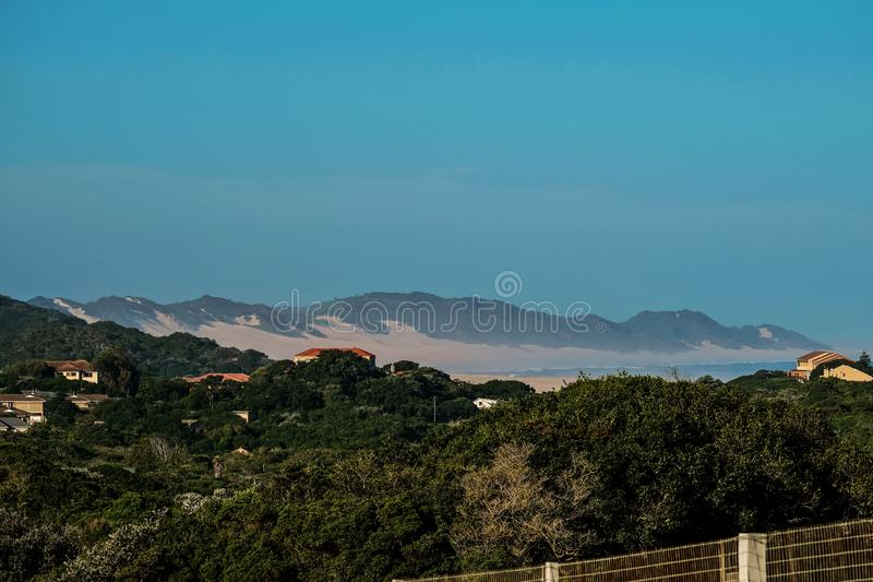 A stunning view of the ocean. A stunning view of the trees, dune and ocean from the second story balcony royalty free stock photos