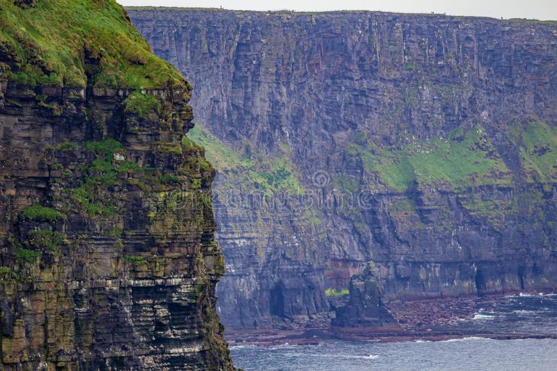 Stunning view of the vertical walls of the Cliffs of Moher. Geosites and geopark, Wild Atlantic Way, wonderful cloudy spring day in County Clare in Ireland stock images