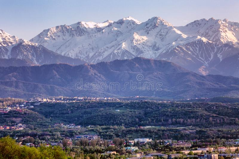 Stunning views of the big city in the mountains at sunset stock photography