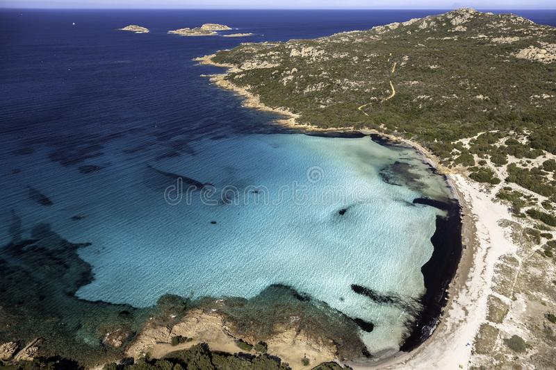 Aerial view of Grande Pevero beach, Costa Smeralda, Sardinia. Stunning white sandy beach with turquoise, blue waters. No people in the image, suitable for royalty free stock image