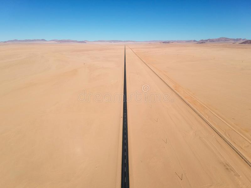 Stunning wide angle aerial drone view of the B4 desert road and a train line between Lüderitz and Keetmanshoop stock photography