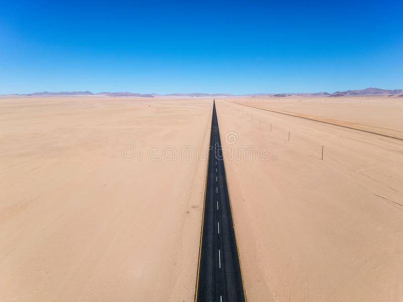 Stunning wide angle aerial drone view of the B4 desert road and a train line between Lüderitz and Keetmanshoop stock image