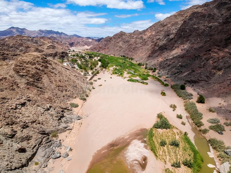 Stunning wide angle aerial drone view of the dry riverbed and mountains near Ai-Ais Hot Springs at the southern end of Fish River. Canyon Karas Region of royalty free stock photos