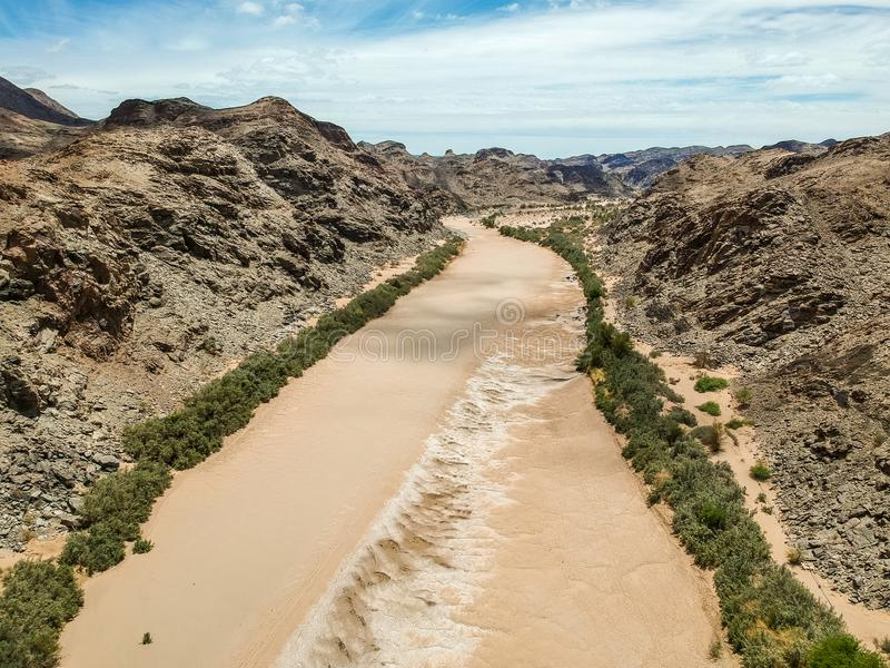 Stunning wide angle aerial drone view of the dry riverbed and mountains near Ai-Ais Hot Springs at the southern end of Fish River. Canyon Karas Region of royalty free stock images