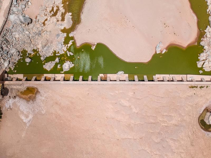 Stunning wide angle aerial drone view of the dry riverbed and an old dam with rests of water near Ai-Ais Hot Springs royalty free stock photo