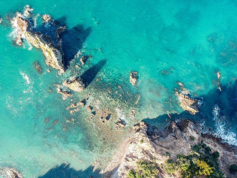 Stunning wide angle aerial drone view of a rock in the water at Otama Beach near Matarangi on the Coromandel Peninsula in New Zeal stock photos