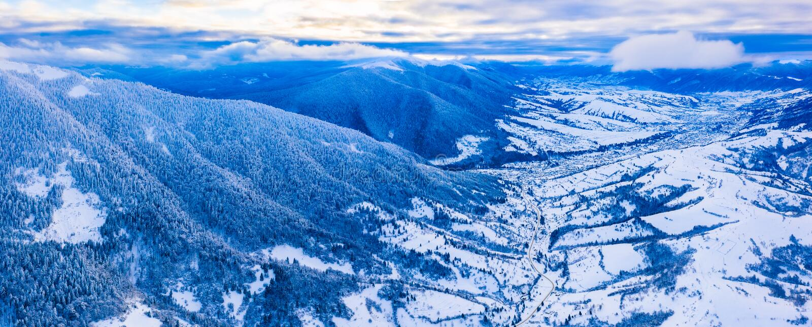 Stunning winter mountains panorama, aerial landscape. Holiday time concept stock photo