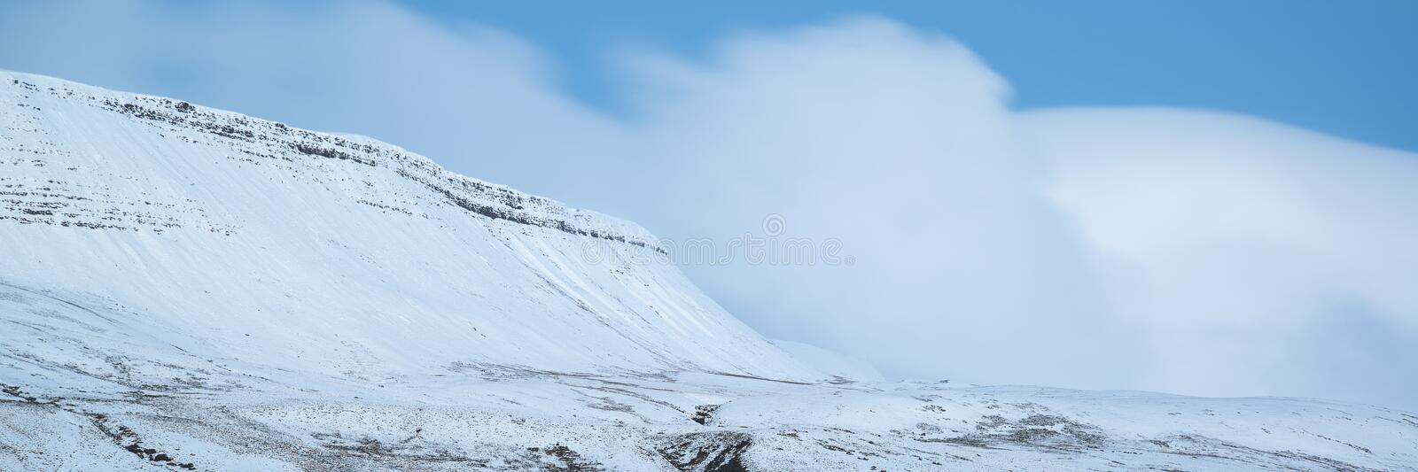 Stunning Winter panoramic landscape snow covered countryside wit. H mountain range royalty free stock images