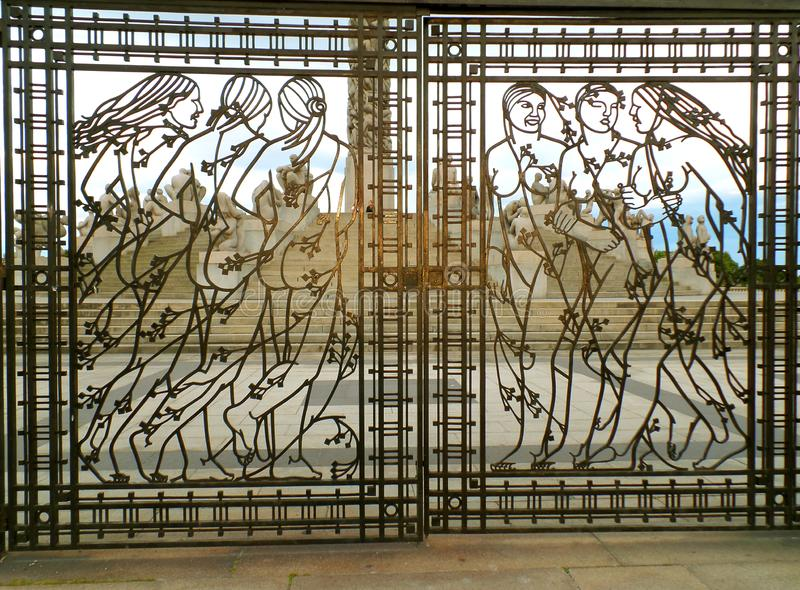 Stunning women figures on wrought iron gate with the Vigeland Installation in background, Frogner Park, Oslo, Norway. Scandinavia, Europe royalty free stock photography