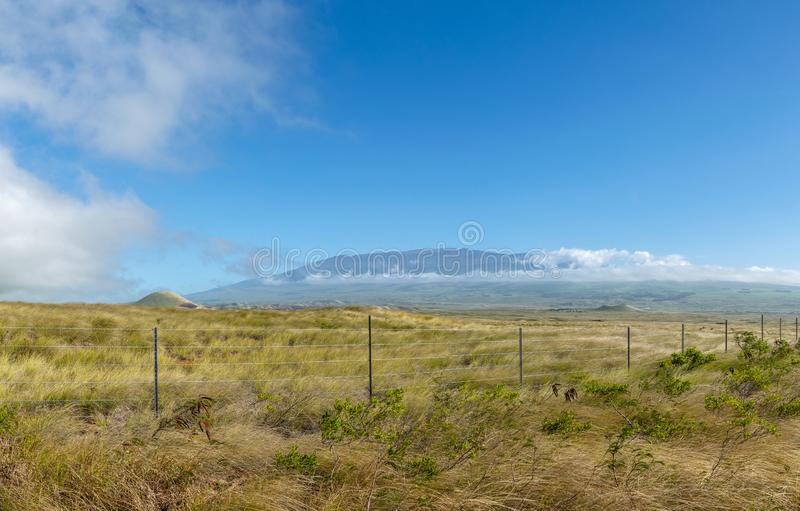 Stunning XXL panorama view of Mauna Kea volcano 4205 metres elevation seen from Highway 190 near the town of Waimea on the Big I stock photos