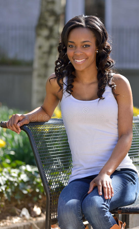 Stunning Young African American Woman White Tank Stock