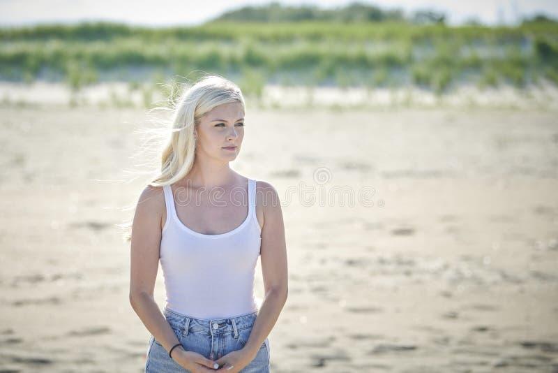 Blonde Woman Fashion Model In White Tank Top Stock Photo