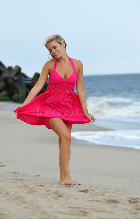 Stunning Young Blonde Woman Walking On The Beach Stock ...
