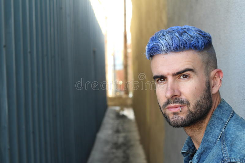 Download Stunning Young Man With Blue Hair Stock Photo