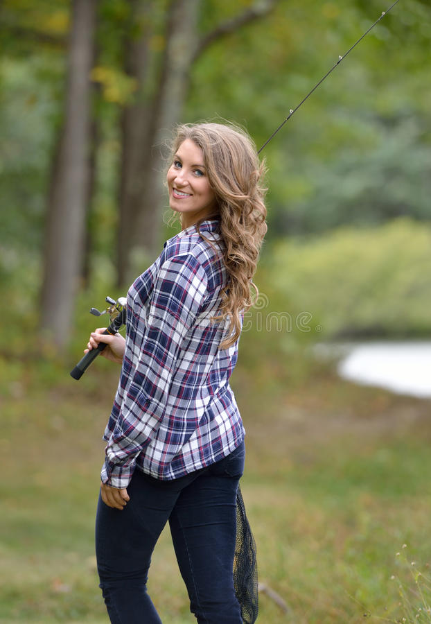 Stunning young woman fishing stock photo image 65271018 for Country girl flannel shirts