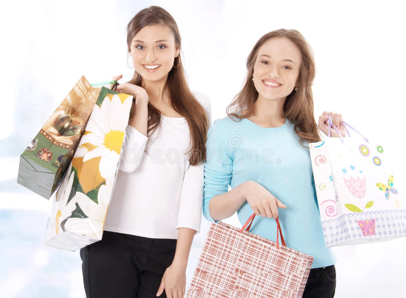 Download Stunning Young Women Carrying Shopping Bags Stock Photo - Image: 26113250