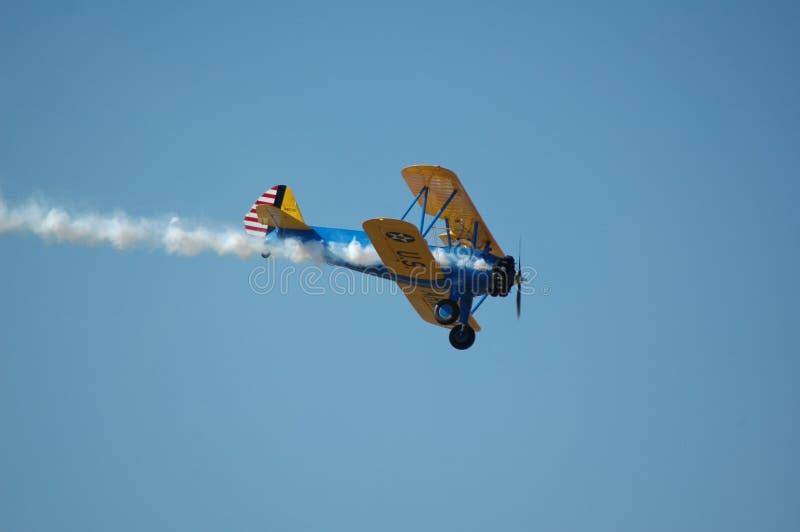 Stunt Biplane 2. Stung biplane against blue sky stock image