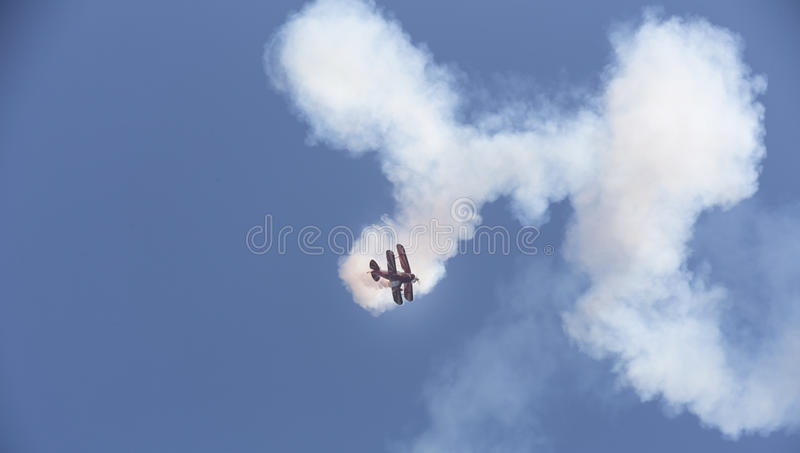 Stunt flyer airplane in the sky. A stunt flyer airplane in the sky royalty free stock photos