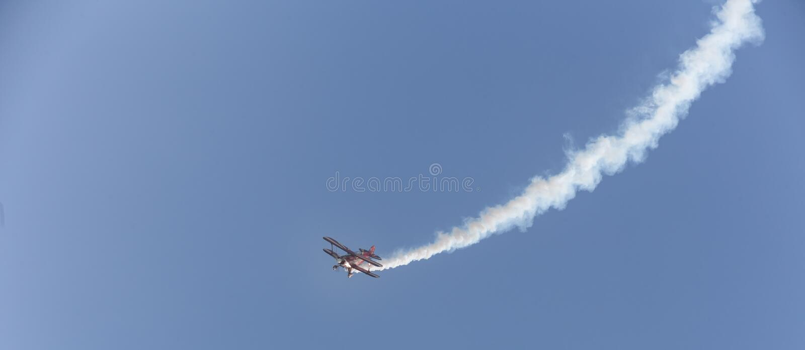 Stunt flyer airplane in the sky. A stunt flyer airplane in the sky stock images