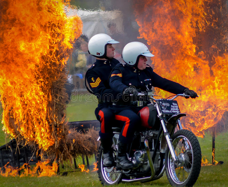 Stunt Motorbike Fire Jump. The White Helmets are a group of specially trained British Army stunt motorbike riders who perform at shows throughout the UK. This royalty free stock photos