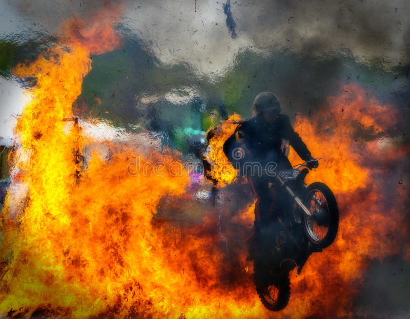 Stunt Motorbike Fire Jump. The White Helmets are a group of specially trained British Army stunt motorbike riders who perform at shows throughout the UK. This
