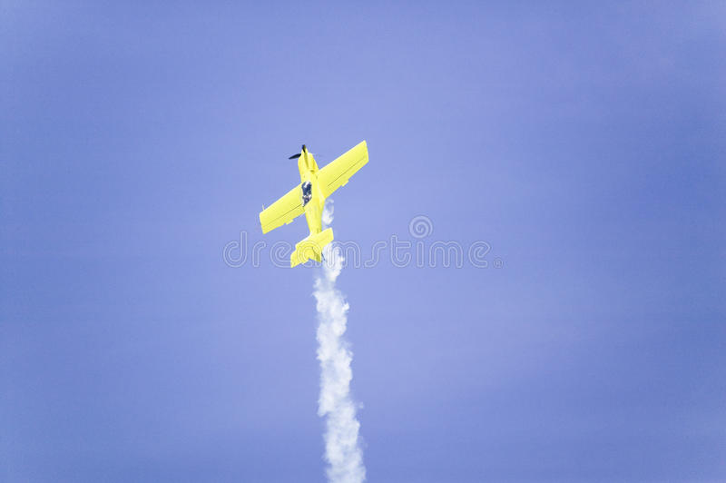 Stunt pilot Rob Harrison flying the Zlin. A bright yellow aircraft called the Tumbling Bear at the 42nd Naval Base Ventura County (NBVC) Air Show at Point Mugu stock photography