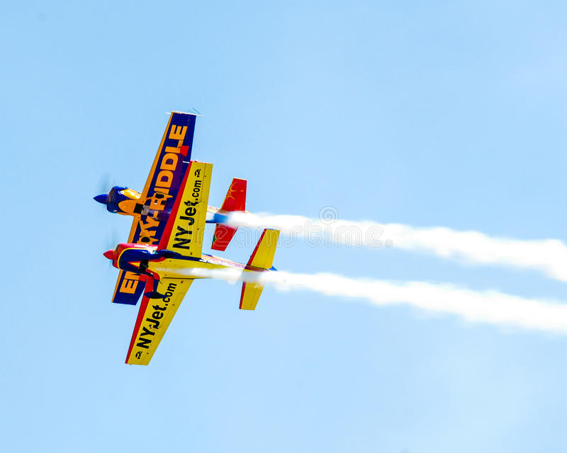 Stunt planes perform at Quonset Airshow. Two Stunt planes go through their routine at the Quonset Airshow, North Kingstown, RI royalty free stock photo
