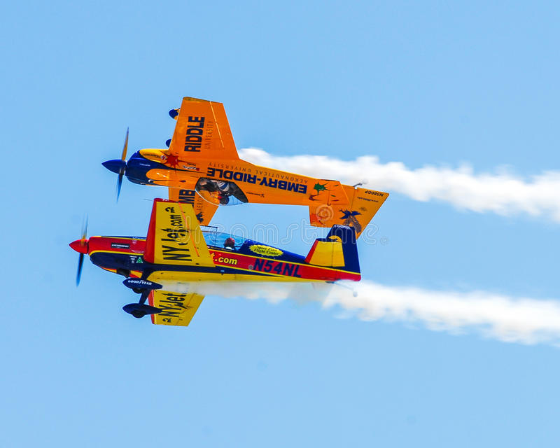 Stunt planes perform at Quonset Airshow. Two Stunt planes go through their routine at the Quonset Airshow, North Kingstown, RI stock image
