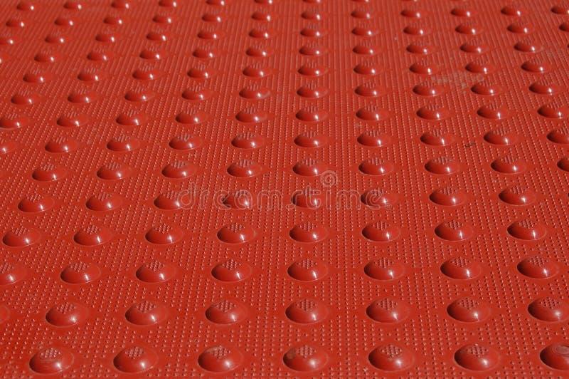 Stuoia strutturata rossa fotografia stock
