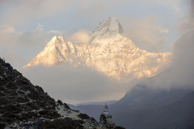 Stupa below great mountain stock photo