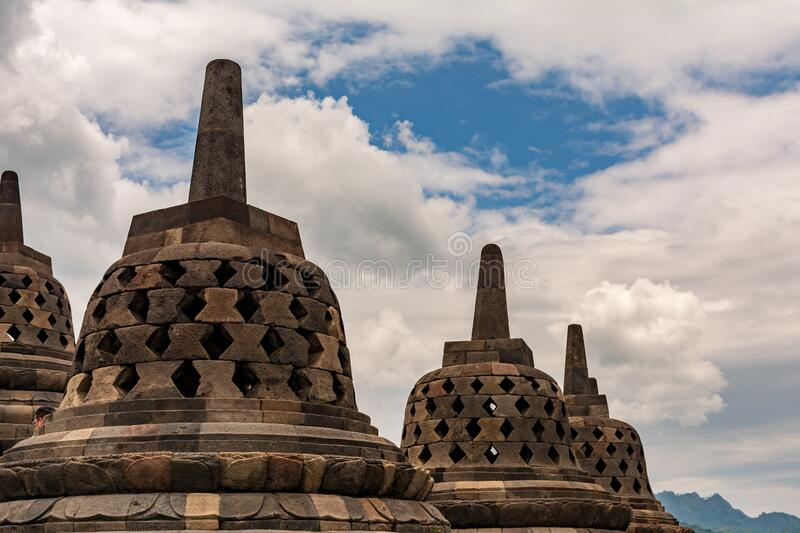 Stupa on borobudur temple with white cloud and blue sky royalty free stock image