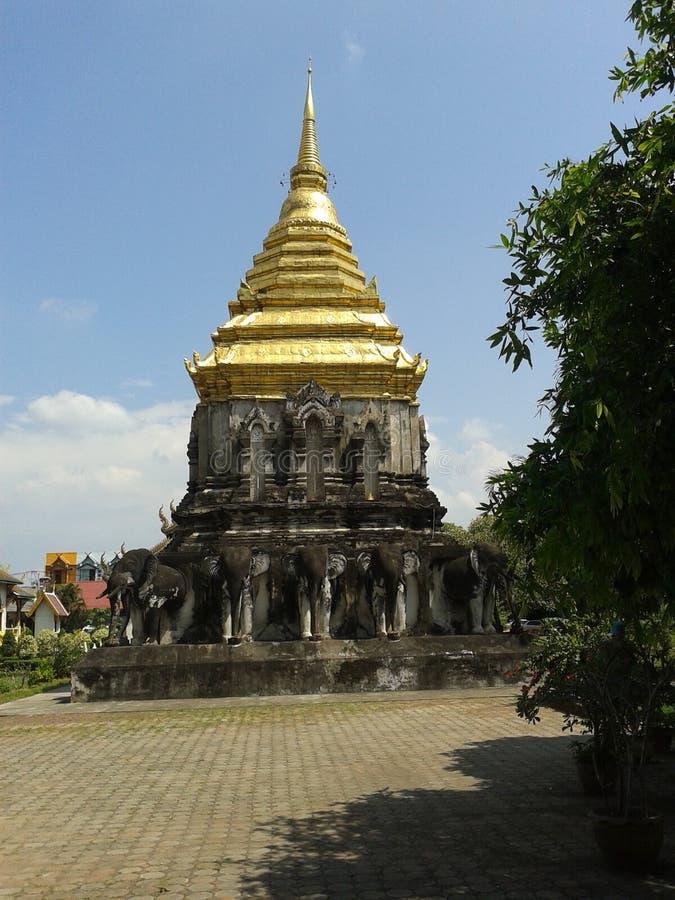 Stupa half golden far royalty free stock images
