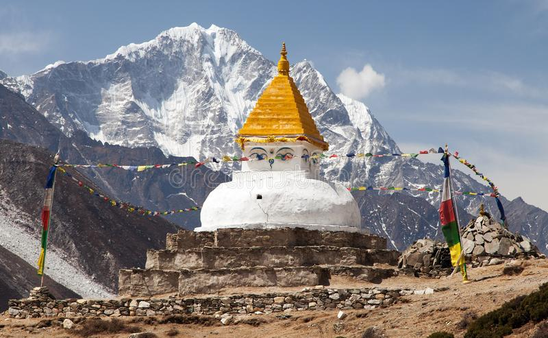 Stupa near Dingboche village with prayer flags. And mounts Kangtega and Thamserku - way to mount Everest base camp - Khumbu valley - Nepal royalty free stock images