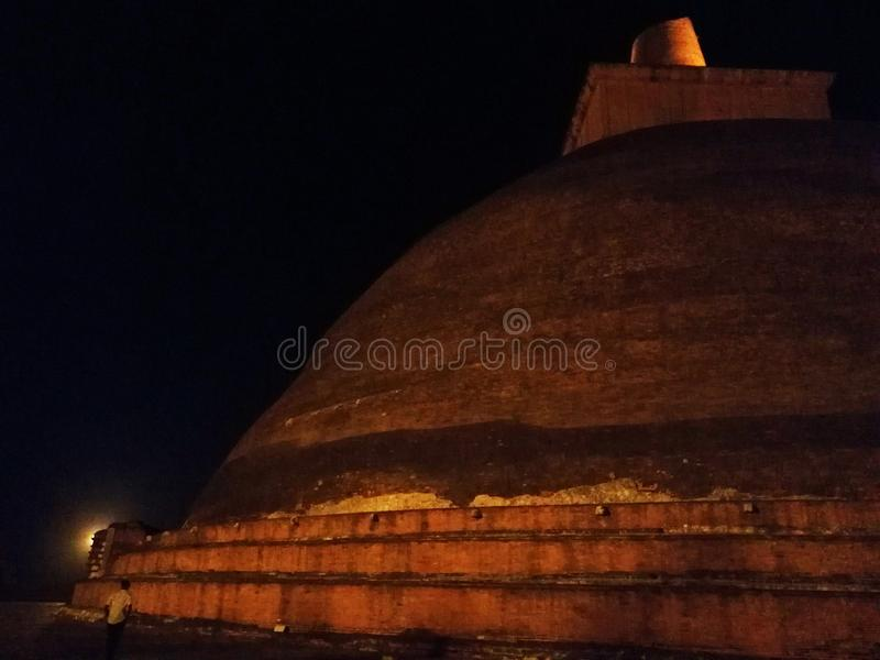Stupa & night sky. The architecture of Sri Lanka displays a rich variety of architectural forms and styles. Buddhism has had a significant influence on Sri royalty free stock photos