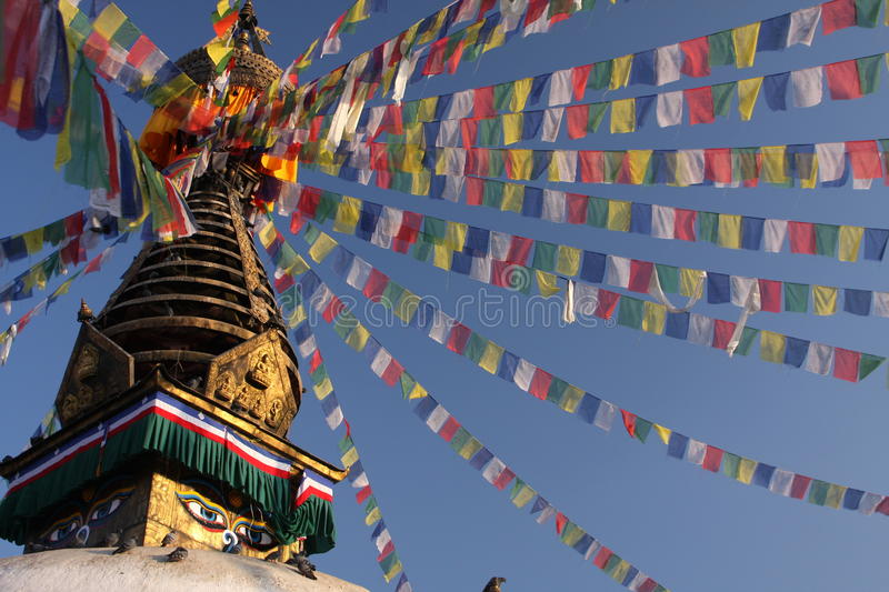 Stupa and prayer flags. Buddhist stupa temple with eyes in Kathmandu, Nepal with decorative and colorful prayer flags stock photography