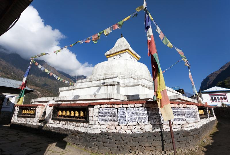 Stupa with prayer flags and wheels. On the way from Lukla to Namche bazar in chaurikharka near chheplung village - nepal royalty free stock photography