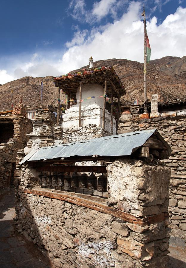 Stupa and prayer wheels wall in Manang villlage. One of the best villages in round Annapurna circuit trekking trail route, Nepal stock photos