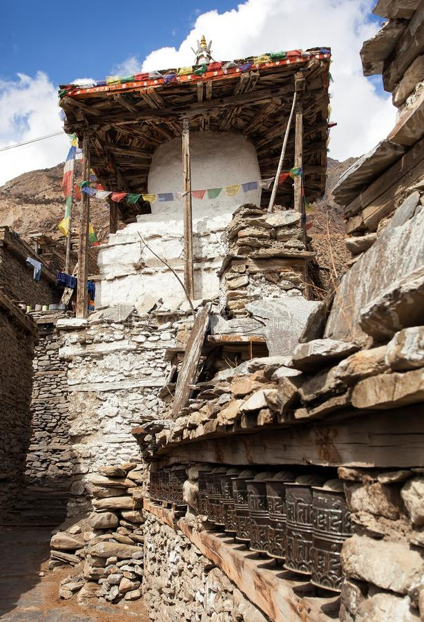 Stupa and prayer wheels wall in Manang villlage. One of the best villages in round Annapurna circuit trekking trail route, Nepal stock images