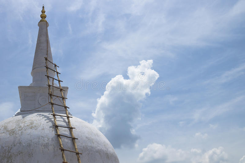 Stupa of Ruwanwelisaya with bamboo ladder, Anuradhapura, Sri Lan. White stupa with bamboo ladder royalty free stock images