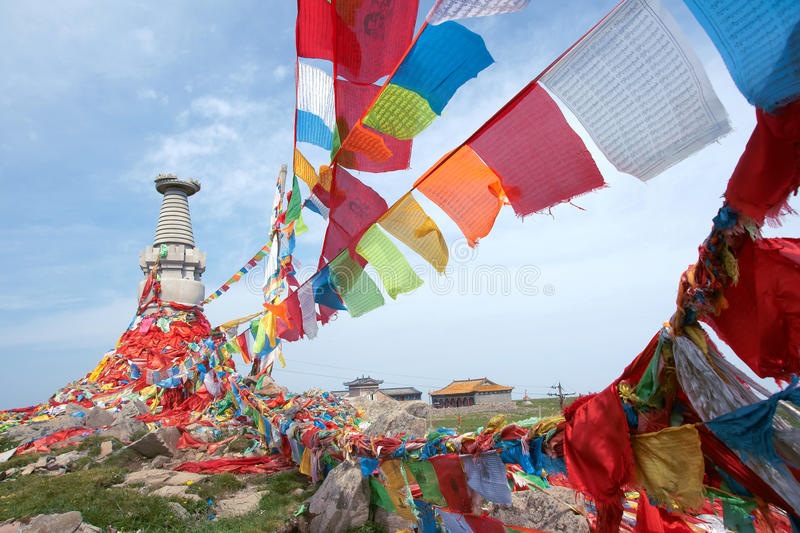Stupa and scripture flags. The scenery of west hilltop in Wutai Mountain, Shanxi, China. Mount Wutai is one of the most famous Buddhist spots stock photos