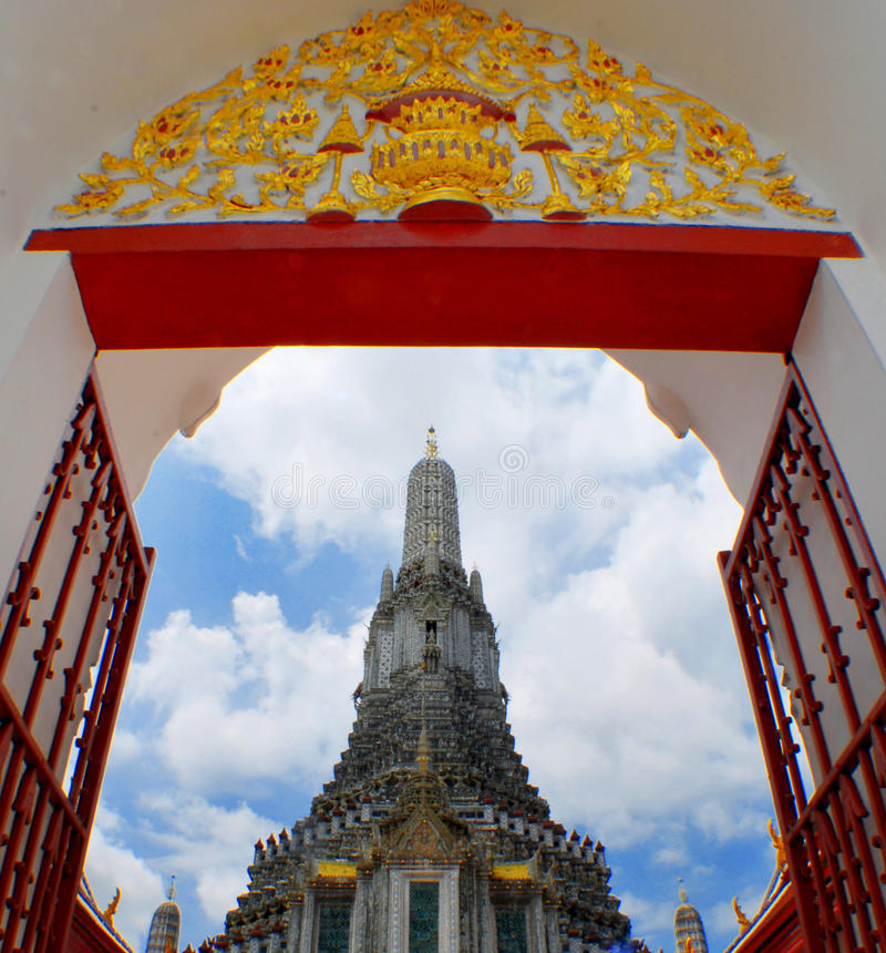 Stupa of Wat Arun. Wat Arun is among the best known of Thailand's landmarks and the first light of the morning reflects off the surface of the temple with pearly royalty free stock images