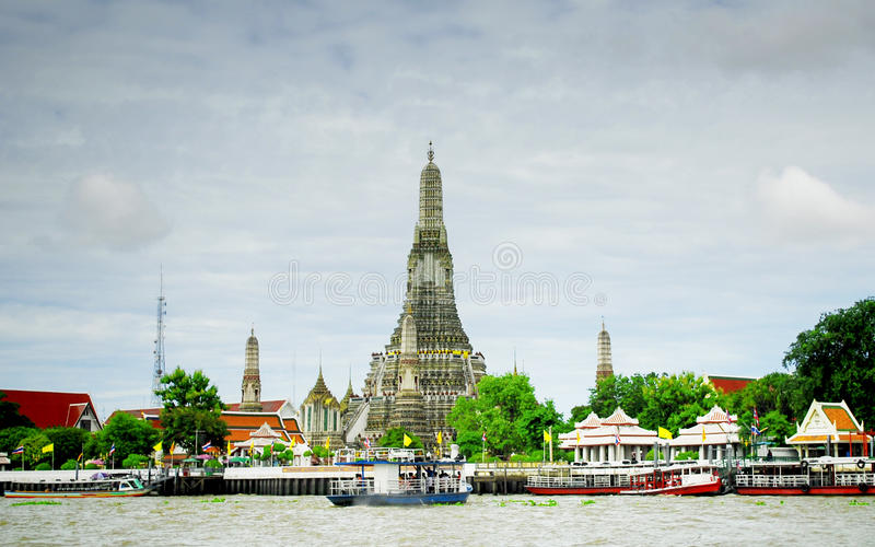 Stupa of Wat Arun. Wat Arun is among the best known of Thailand's landmarks and the first light of the morning reflects off the surface of the temple with pearly stock photography