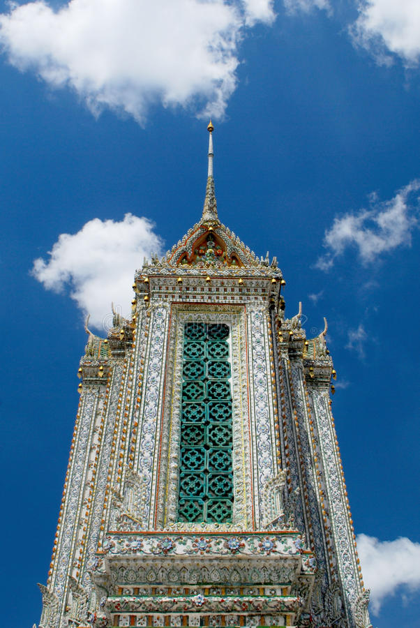 Stupa of Wat Arun. Wat Arun is among the best known of Thailand's landmarks and the first light of the morning reflects off the surface of the temple with pearly stock photo