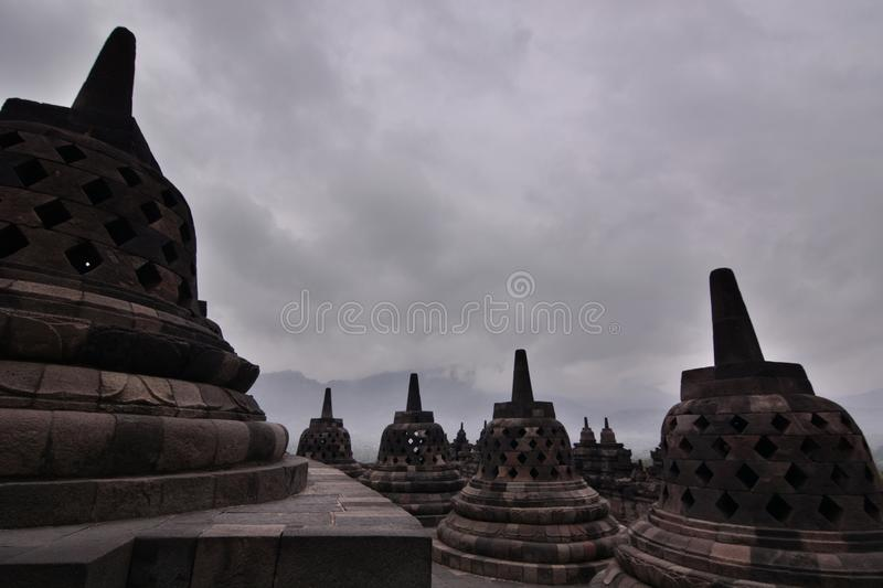The stupas in a cloudy morning. Borobudur temple. Magelang. Central Java. Indonesia. Borobudur, or Barabudur, is a 9th century Mahayana Buddhist temple in stock photo